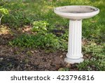 Empty White Birdbath In A...