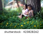 teaching a class of children in ... | Shutterstock . vector #423828262