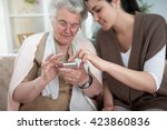 old woman learning to use... | Shutterstock . vector #423860836