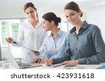 Business Women Team Working At...