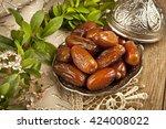 dried date palm fruits or kurma ... | Shutterstock . vector #424008022