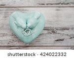 green porcelain box with birds... | Shutterstock . vector #424022332