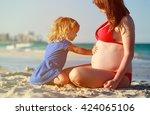 little girl listening to... | Shutterstock . vector #424065106