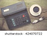 Old Calculator And Coffee On...
