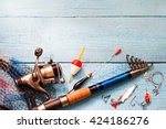 Small photo of Fishing tackle on wooden blue background