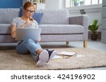 studious young woman working at ... | Shutterstock . vector #424196902