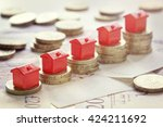 minature houses resting on... | Shutterstock . vector #424211692