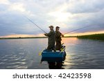 Two Fisherman On Boat. Catching ...
