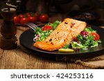 baked salmon served with fresh... | Shutterstock . vector #424253116
