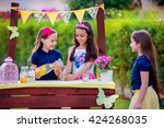 three young girls at their... | Shutterstock . vector #424268035