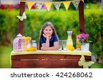 young girl at her lemonade stand | Shutterstock . vector #424268062