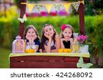 three young girls at their... | Shutterstock . vector #424268092