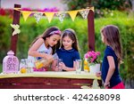 three young girls at their... | Shutterstock . vector #424268098