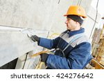 facade plasterer sealing joint... | Shutterstock . vector #424276642