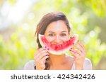 beautiful young woman showing a ... | Shutterstock . vector #424342426