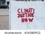 climate justice now sign... | Shutterstock . vector #424380922