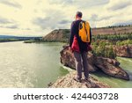 hiking man in the mountains | Shutterstock . vector #424403728