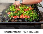 mussels cooked with white and... | Shutterstock . vector #424482238