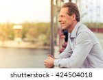 side view of handsome middle... | Shutterstock . vector #424504018