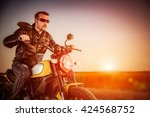 biker man wearing a leather... | Shutterstock . vector #424568752