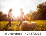 young couple with the dogs in...   Shutterstock . vector #424573318