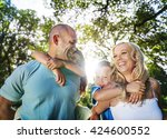 family playing outdoors... | Shutterstock . vector #424600552