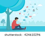 young man sitting in the park... | Shutterstock .eps vector #424610296
