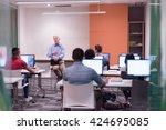 handsome mature teacher and... | Shutterstock . vector #424695085