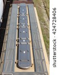 Detail overhead view of grain car including hatches and walkway - stock photo
