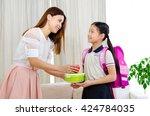 asian mother get her daughter... | Shutterstock . vector #424784035