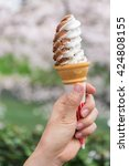 a hand holding ice cream soft... | Shutterstock . vector #424808155