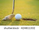 close up golf ball on lip of... | Shutterstock . vector #424811332