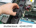 computer technician installing... | Shutterstock . vector #424812592