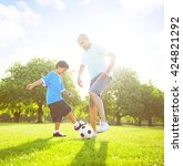 little boy playing soccer with... | Shutterstock . vector #424821292