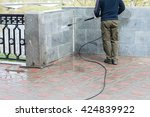 Construction Worker Cleaning...