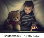 kid under the blanket playing... | Shutterstock . vector #424877662