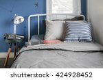 beige and striped pillow on... | Shutterstock . vector #424928452