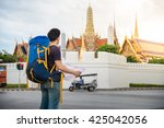 backpacker with a map at wat... | Shutterstock . vector #425042056