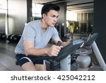 a man doing indoor biking in a...   Shutterstock . vector #425042212