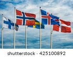 The flags of the countries of Scandinavia waving in the sky of a beautiful summer day.
