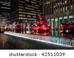 MANHATTAN - DECEMBER 7: Bright holiday lights are a big tourist attraction around Rockefeller Center on December 7, 2009 in New York City. - stock photo