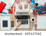 coworkers sharing the same desk ... | Shutterstock . vector #425117242