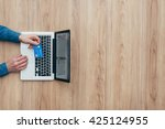 man working at desk and... | Shutterstock . vector #425124955