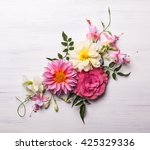 Stock photo festive flower composition on the white wooden background overhead view 425329336