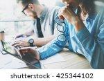 coworking team brainstorming... | Shutterstock . vector #425344102