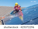 young worker cleaning solar... | Shutterstock . vector #425372296