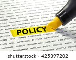 Small photo of Word Policy highlighted with marker on paper of other related words.business success concept.
