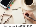 young man right hand writing on ... | Shutterstock . vector #425414335