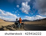 a man with the motorbike on the ...   Shutterstock . vector #425416222