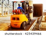 forklift is putting cargo from... | Shutterstock . vector #425439466